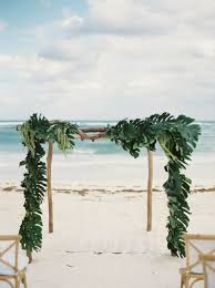 wedding arches coast picture of a wooden wedding arch covered completely with palm leaves