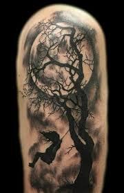 grey ink moon and tree on left half sleeve