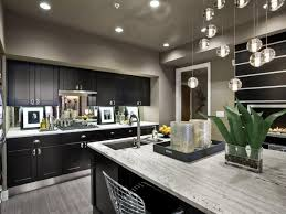 kitchen cabinets with gray floors gray contemporary kitchen with black cabinets hgtv