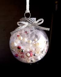 christmas decoration filled with strings of pearls in natural red