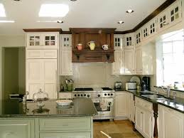 green kitchen cabinets with white island cabinet and trim colors in kitchen with glaze