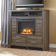 signature design by ashley juararo media chest with fireplace