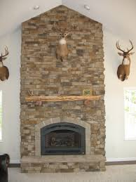 graceful stone along with stacked stone electric fireplace