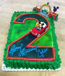mickey mouse cake mickey mouse cake with number shaped road trefzger s bakery