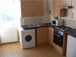 kitchen appliances white wooden kitchen cabinet and small belfast