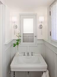 wainscoting bathroom ideas pictures bathrooms chrome sconces fixtures gray wainscoting gray pedestal