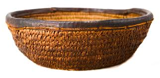 primative native american indian hand woven basket with leather