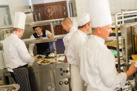Professional Kitchen Group Of Cooks In Professional Kitchen Prepare Meals Restaurant