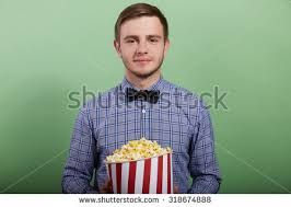 popcorn hairstyle young guy short hairstyle holds popcorn stock photo 317710841