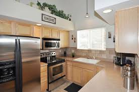 white kitchen cabinets compliment stainless steel appliances