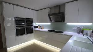 black glass backsplash kitchen small u shaped kitchen with peninsula countertop design black