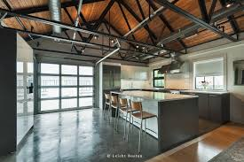 kitchen style glossy gray cabinets industrial hanging light