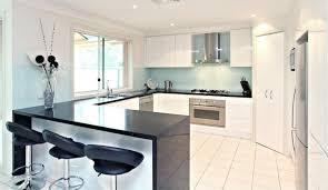 White And Blue Kitchen - white kitchen black benchtop interior design