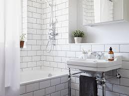 bathroom basket bathtub daylight faucet towel storage glass