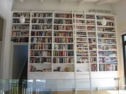 large and high white wooden books shelves and storage combined