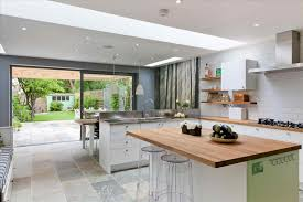 open plan kitchen with island room dining white cabinets bar