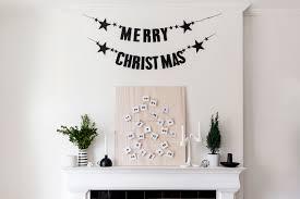 diy modern scandinavian advent calendar with free printable diy scandinavian inspired advent calendar christmas fireplace mantle decor happy grey lucky