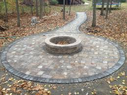 fire pit in the woods brick paver patio and tumbled paver stone