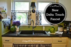 new kitchen faucet our new delta touch2o kitchen faucet