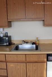 can you paint formica kitchen cabinets kitchen cabinets bathroom update how to paint laminate cabinets laminate cabinets
