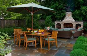 outdoor fireplace patio rustic with traditional flower pots