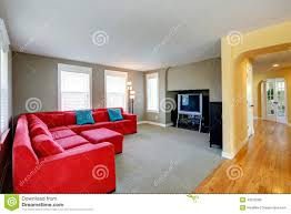 Living Room With Red Sofa by Living Room With Bright Red Couch And Tv Stock Photo Image 43910280