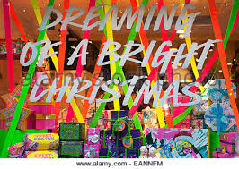 Bright Christmas Decorations A High Street Shop Window Decorated For Christmas With Display Of