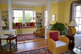 designing a window seat ideas in modern home living room apartment yellow wall paint decorating with window seat construction in bay window using red and pink patterns