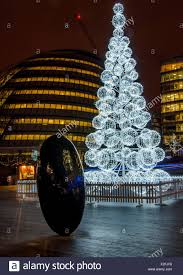christmas tree at the queens walk and city hall in background