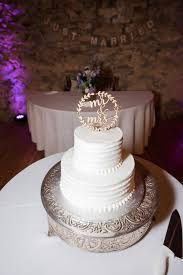 white rustic wedding cake with wood topper favors for parties