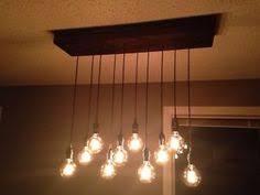 Light Fixtures Calgary Rustic Wood Chandelier With Edison Bulbs Calgary Alberta Image 1