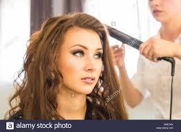 hairdresser doing haircut for women in hairdressing salon concept