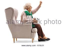 Armchair Supporter Excited Elderly Soccer Fan With A Scarf And A Football Cheering