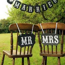 wedding photo booth ideas diy black brown mr mrs paper board ribbon sign photo booth props
