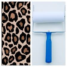 patterned paint roller in leopard print design and applicator by