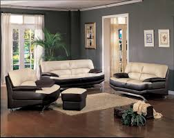 black and cream leather couch on dark brown wooden floor completed