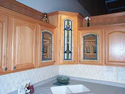 furniture brown stained wood kitchen cabinet with accent glass