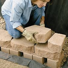 build a retaining wall with landscape blocks garden club