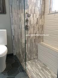 bathroom hexagonal tile floor with linear shower drain and merola