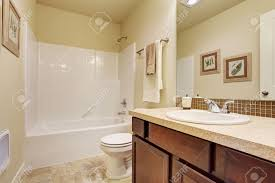 what color cabinets with beige tile empty bathroom interior in soft ivory color bathroom vanity