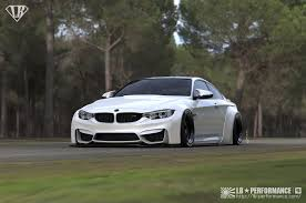 modified bmw m4 liberty walk body kit makes bmw m4 appear more aggressive