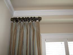 Long Curtain Hall Extra Long Curtain Rods With Brown Curtain And Glass Windows