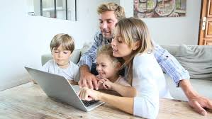 family at home with laptop computer stock footage