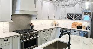 wall tiles for white kitchen cabinets white kitchen with geometrc tile home stores
