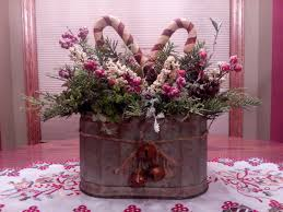 candy cane christmas centerpiece in a galvanized tin rustic
