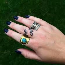 25 trending flower finger tattoos ideas on pinterest flower