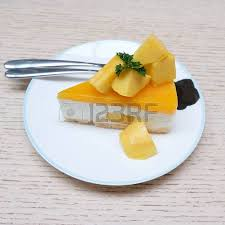 homemade mango cheesecake with red spoons stock photo picture and