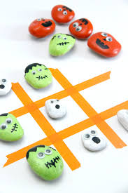 super cute spooky tic tac toe game using halloween painted rocks