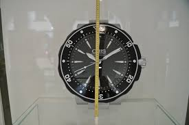 oris aquis wall clock for 1 439 for sale from a trusted seller on