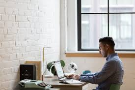 picture of young man working at desk free stock photo